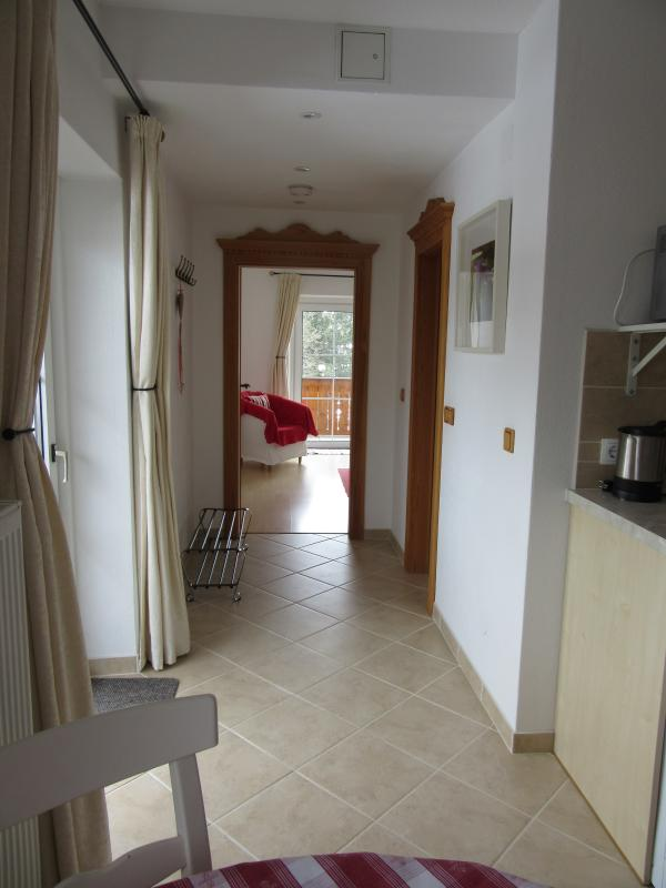 Looking towards the bedroom; bathroom is on the right
