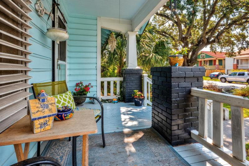 Unwind on the charming front porch and enjoy the balmy weather