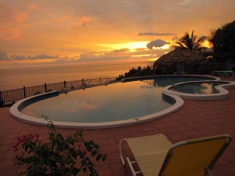 Spectacular sunsets overlooking the Jacuzzi, pool, and Caribbean Sea