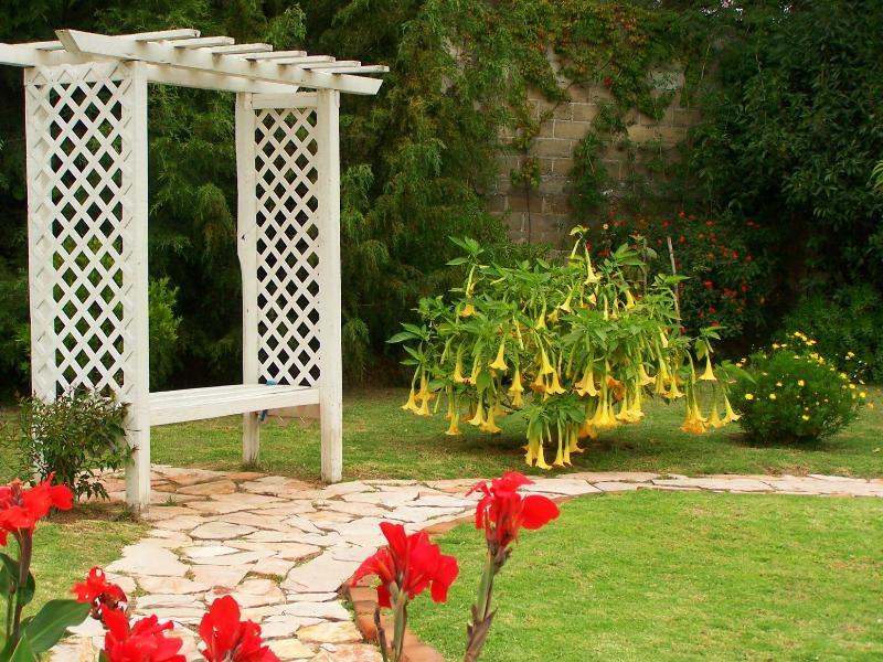 Upper garden with arbor.