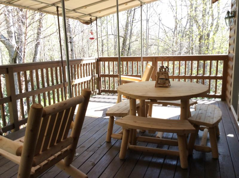 Upstairs covered deck with outdoor dining