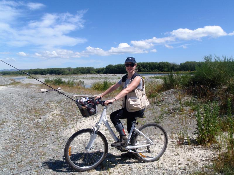 Cycling to a favorite fishing section of the nearby Oreti River.