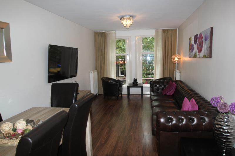 living room with large flatscreen, smart TV overlooking the beautiful Rembrandt Square