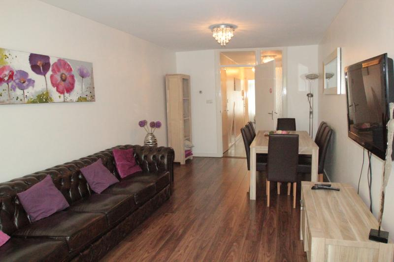spacious livingroom with large flatscreen,smart TV and comfy chesterfield sofa