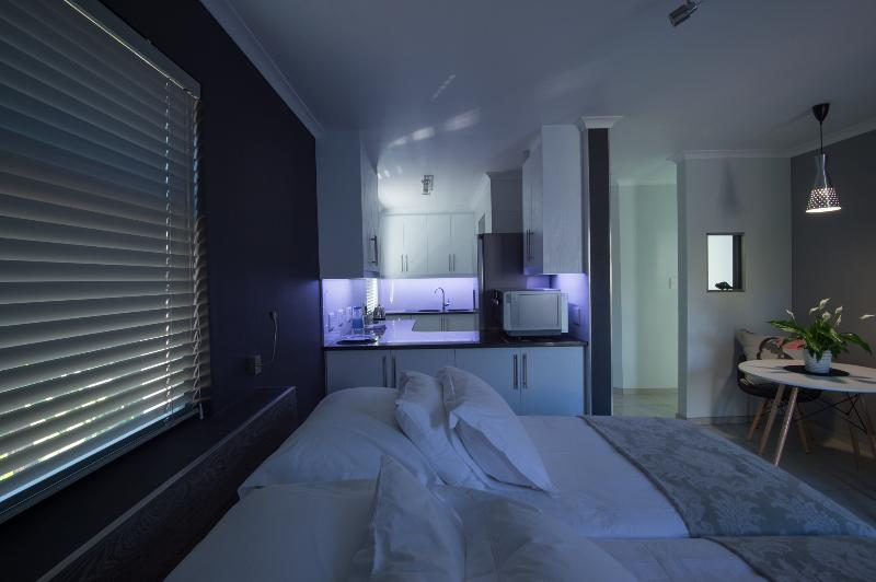 Cat's Eye Jewel bedroom with view to the kitchen