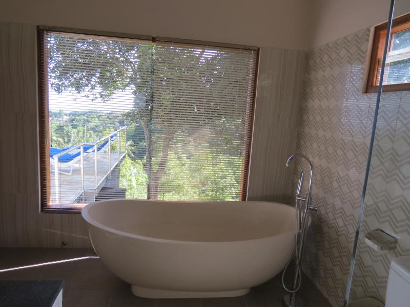 Master Bedroom En-suite with bath. Take a bath, perhaps enjoy a cool drink and enjoy the view