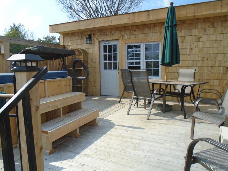 Top level of 3 levels of decking. The cool/cold tub, swing and sitting area can be found here.
