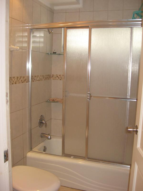Bathroom - with WC shower and over bath shower doors.