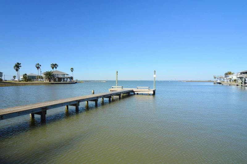 Private fishing pier, 1 block from the house. Complete with lights, bench, and nearby fish cleaning