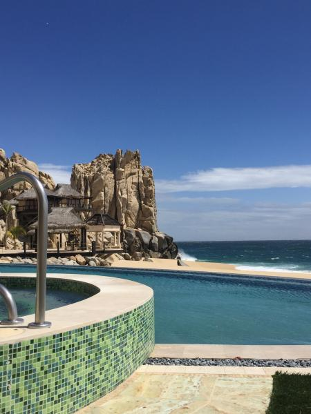 1 of several pools. This is VIP Adults only.  Also has the sea spa cabanas in the rocks to the left