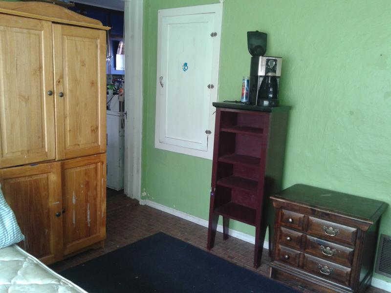 Room armoire,  door to kitchen,  coffee maker