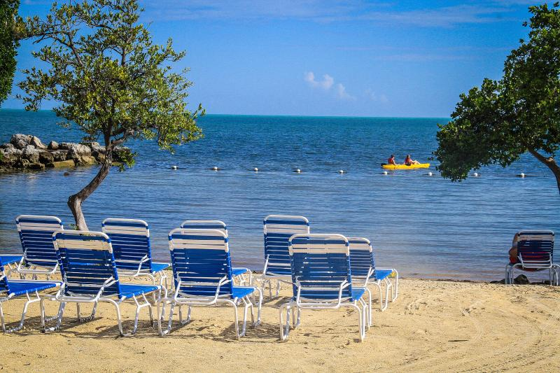 Relax and rewind in the clear turquoise waters and beach at Tarpon Cove.