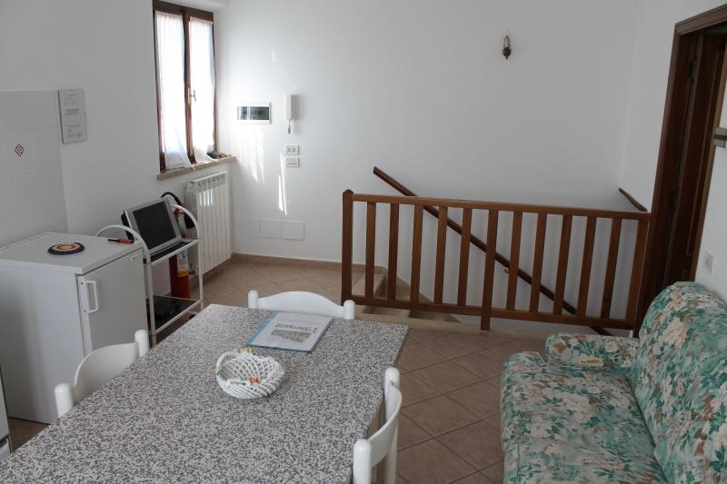 A large living room with fully equipped kitchen is ready to guest you.