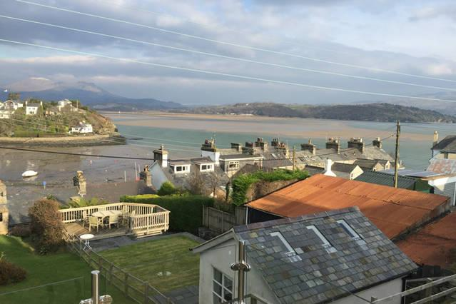 view of estuary and Snowdonia from deck