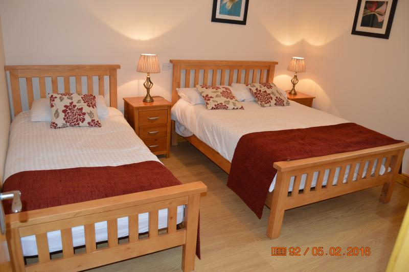 Spacious and comfortable bedroom with a double and a single bed