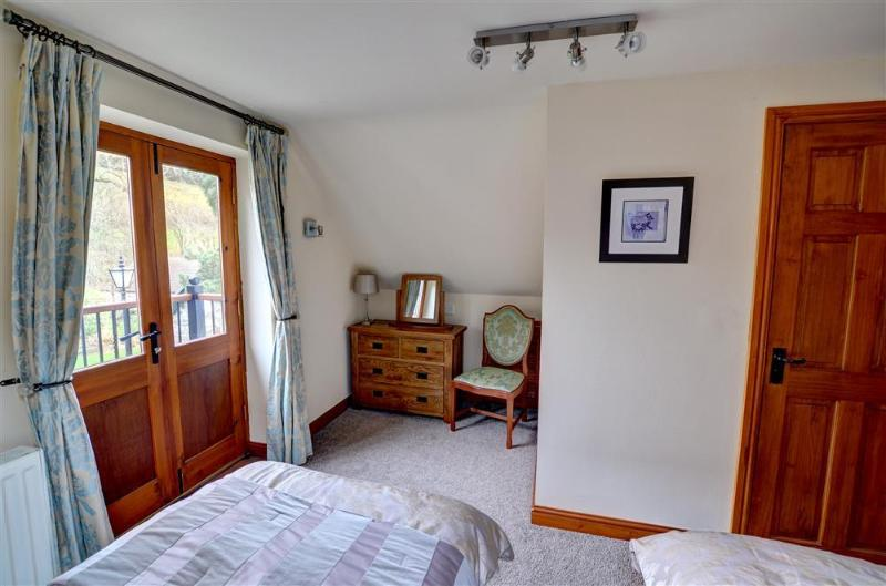 An attractive dressing table area in the second twin bedroom