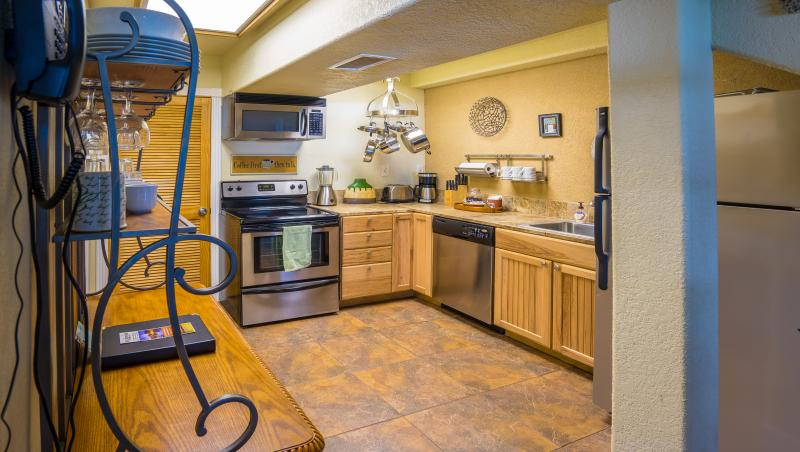 Santa Fe condo fully equipped kitchen with dishwasher and full sized refrigerator