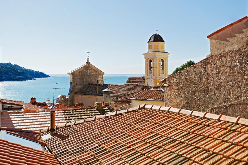 View from your window, overlooking the Rade of Villefranche, the iconic church tower and tiled roofs