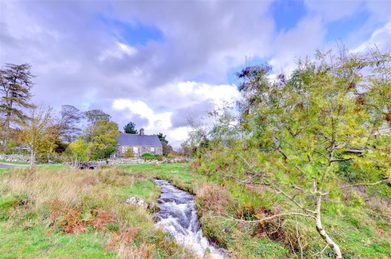 There is lovely open countryside surrounding the cottage, with a stream tumbling down the hillside