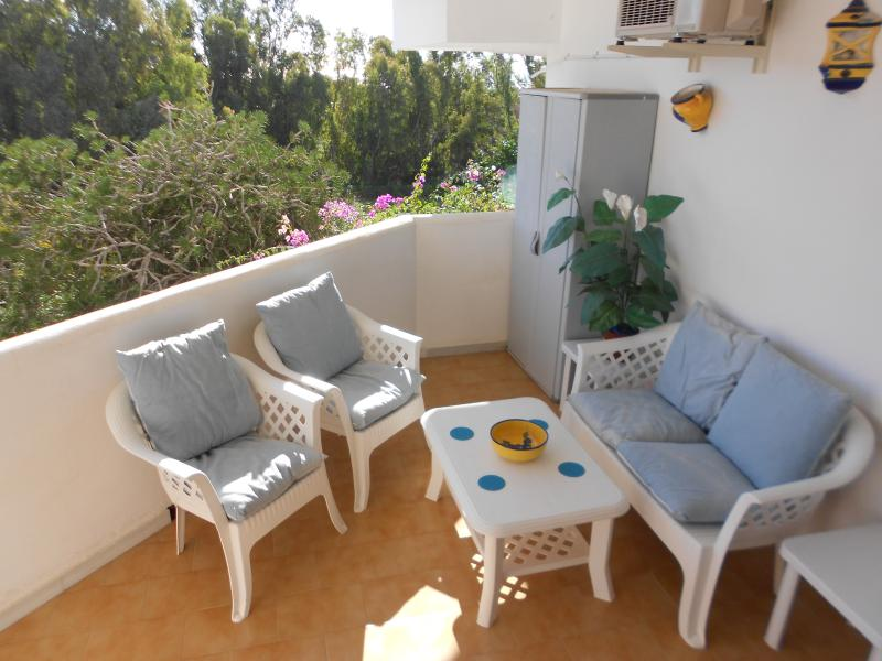 Balcony accessed from both bedrooms overlooking gardens ∧ pool area