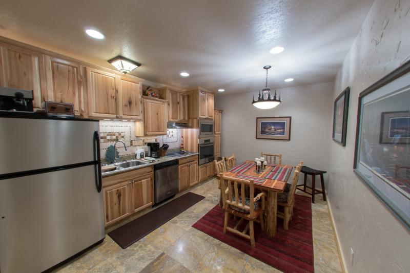 The dine-in kitchen has all the comforts of home - fridge w/icemaker, dishwasher, microwave & oven