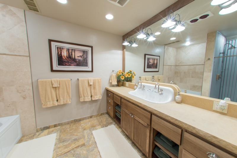 The huge bathroom with travertine floors, soft rugs and plenty of room to spread out...
