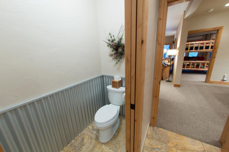 Commode is in a separate area with a pocket door for privacy.
