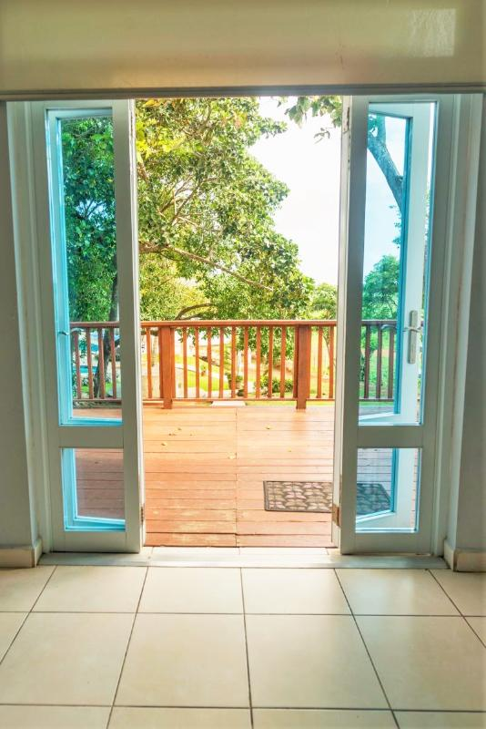 Exit to the Jacuzzi and pool view balcony with your private BBQ