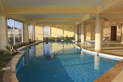 Indoor pool with fully equipped gym area.