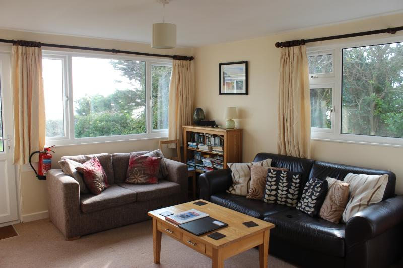 Living room with sea views, access to private patio, garden and cliff path