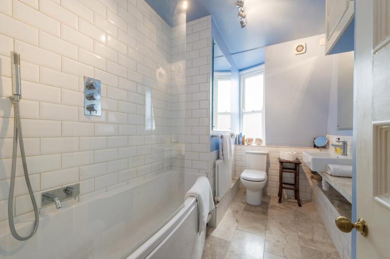 Serene and relaxing bathroom, featuring terrazzo floor.