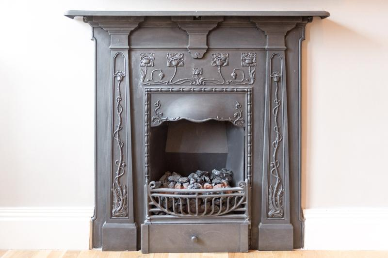Art nouveau antique fireplace, with coal-effect electric fire (remote controlled).