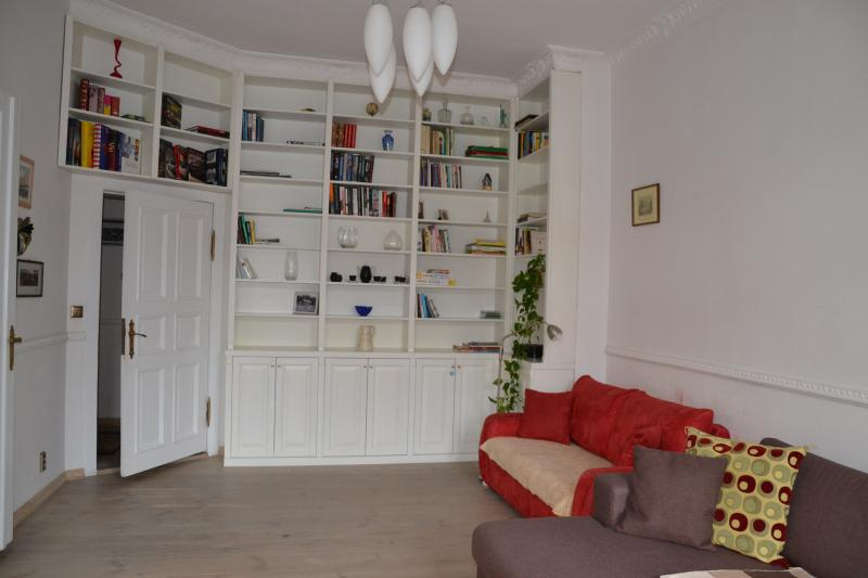 The red sofa is a 2 person sofabed. Library with books in English, Polish, Danish.