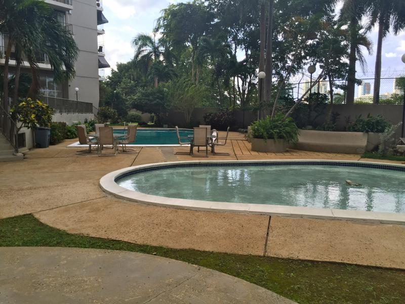 Kid's pool adjacent to larger pool.