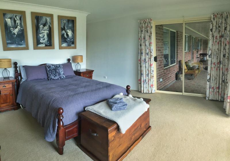 The master bedroom has spectacular views from its front windows. Wake up with the rising sun!