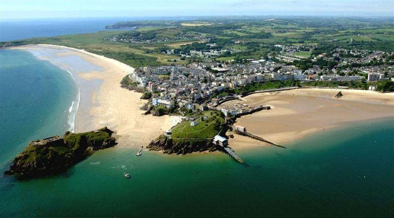 Aerial view of Tenby with its sandy beaches, harbour, shops & restaurants a short drive away