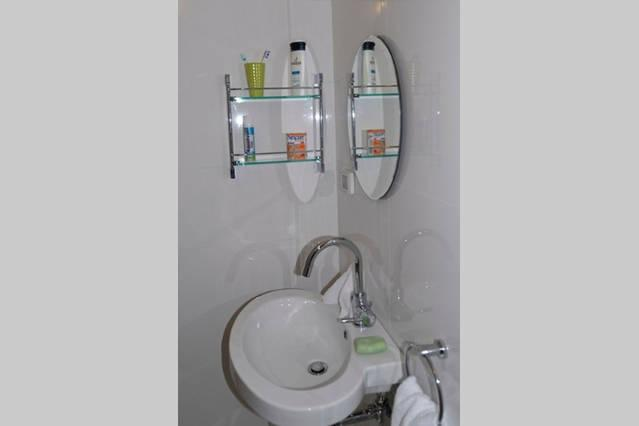 Modern, clean bathroom with shower and washer and dryer available on-site