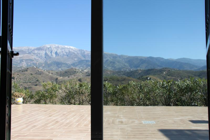 View through patio doors in lounge