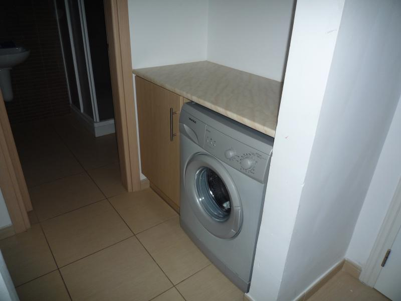 Utility area with washing machine. Iron and Ironing board also available for your use.
