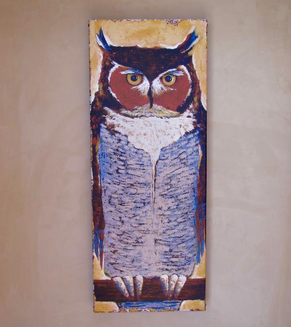The metal art owl which gives the home its name greets you.