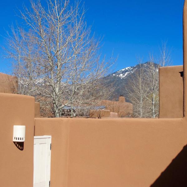 The patio has a beautiful view of Taos mountain.