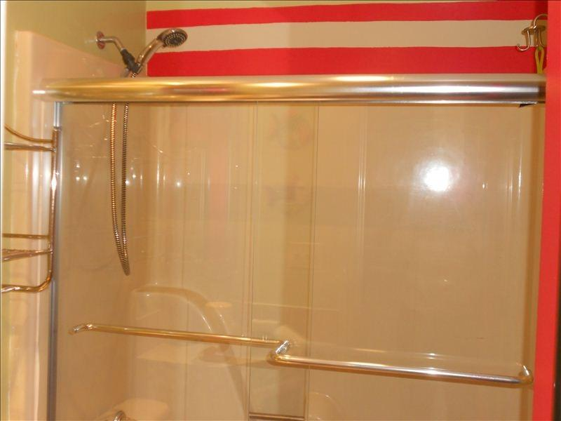 Glass shower doors, great shower head, storage for towels. Easy access from beach for  pit stops.