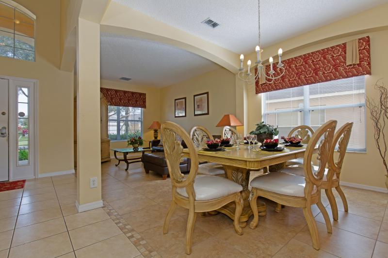 Formal dining and a view of the living room