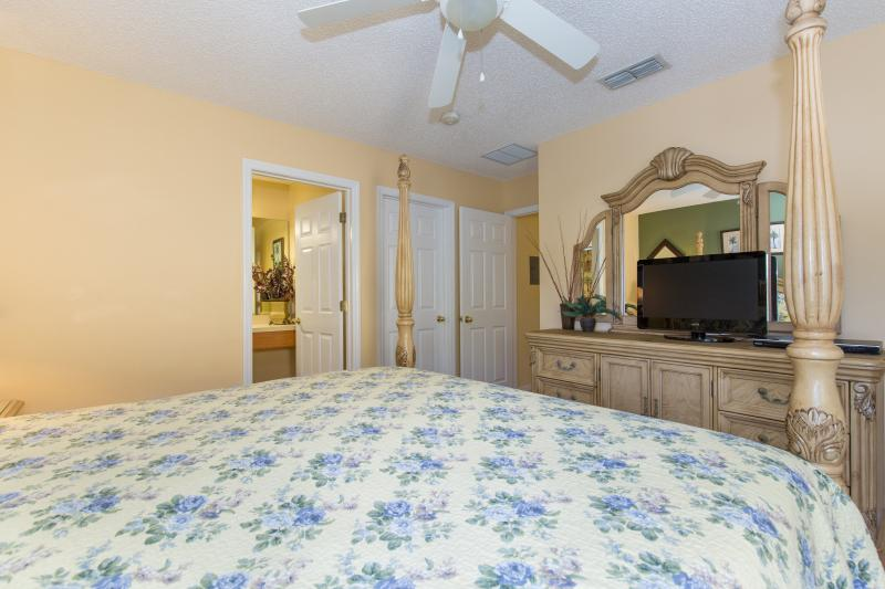 This bedroom has a flat-screen TV, DVD  player and a large walk-in closet.
