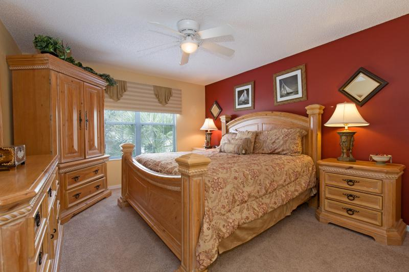 King master suite #3, this bedroom has a closet and a flat-screen TV and DVD player