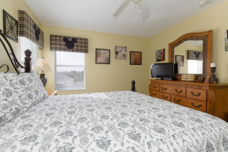 King master suite #4, this bedroom has a closet and a flat-screen TV and DVD player