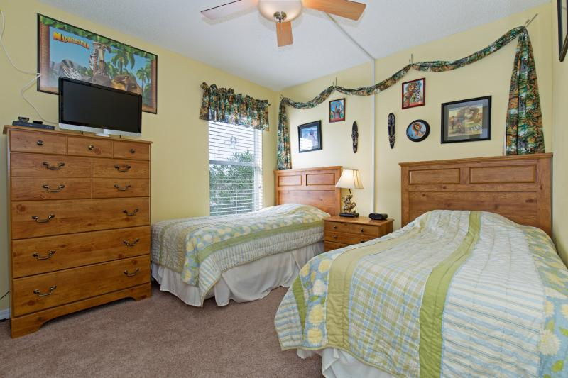 Kids bedroom with two twin beds, flat-screen TV and DVD player