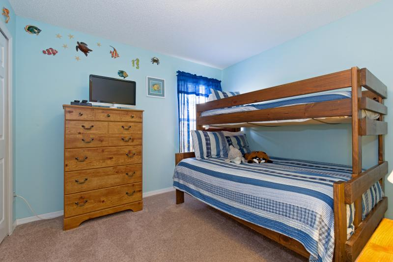 Kids bedroom with twin over full bunk bed, flat-screen TV and DVD player