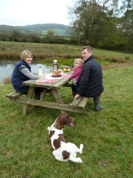 A family picnic by the pond last Autumn