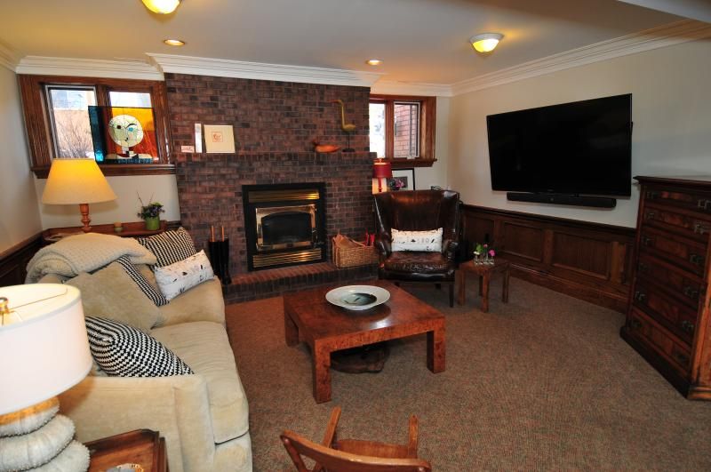 Media/sitting room. 60' TV with stereo.